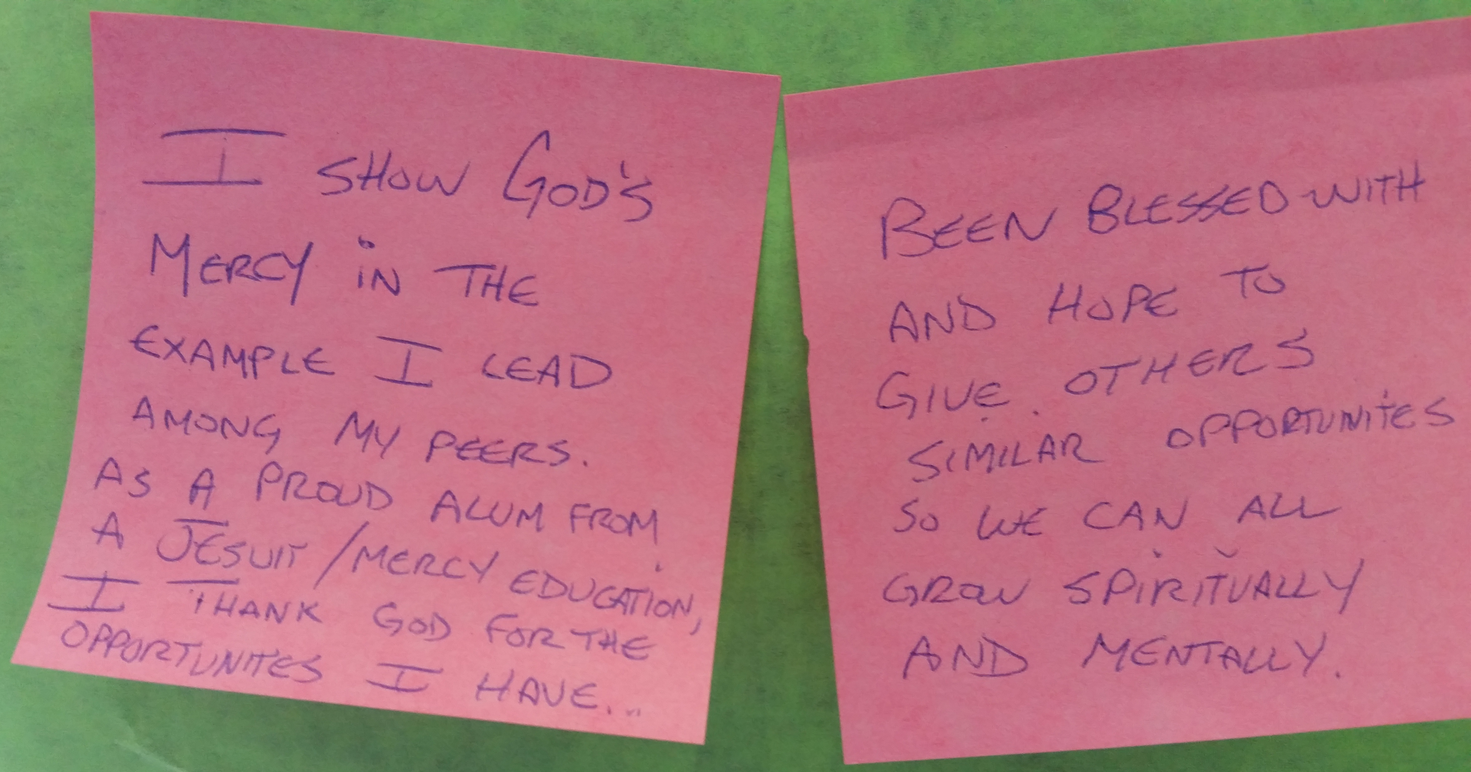 Students, alumni, faculty and staff posted ways they give and receive Mercy on boards around the McNichols Campus.