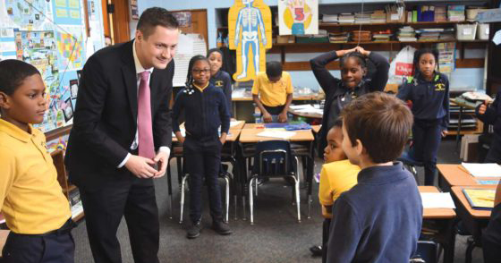 Titan comes home to oversee archdiocese schools