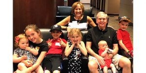 Bill and Sue Wales with six of their biggest blessings, their grandchildren.