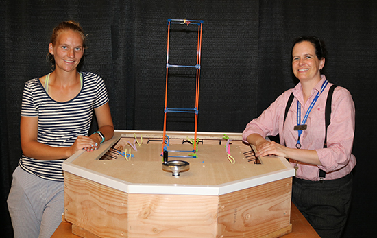 Detroit Mercy student Nynke Van Der Goot, left, and Cassie Byrd, chief learning officer at the Michigan Science Center, with the table.