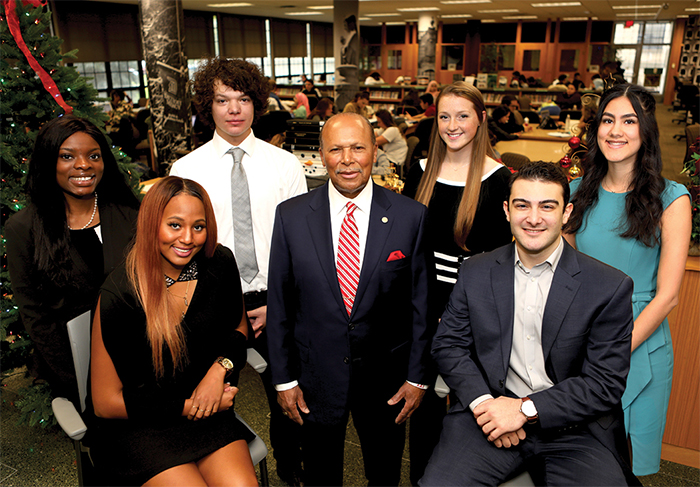 President of University of Detroit Mercy with students