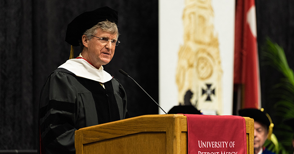 Rip Rapson of the Kresge Foundation addresses the crowd at the undergraduate commencement.