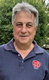 Tash wears his University of Detroit Alumni shirt.