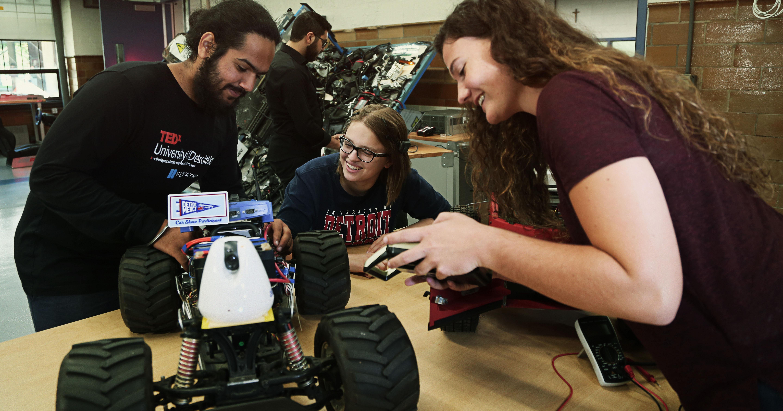 Engineering students work on an autonomous vehicle.