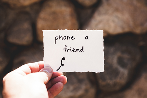 A note reminding you to phone a friend
