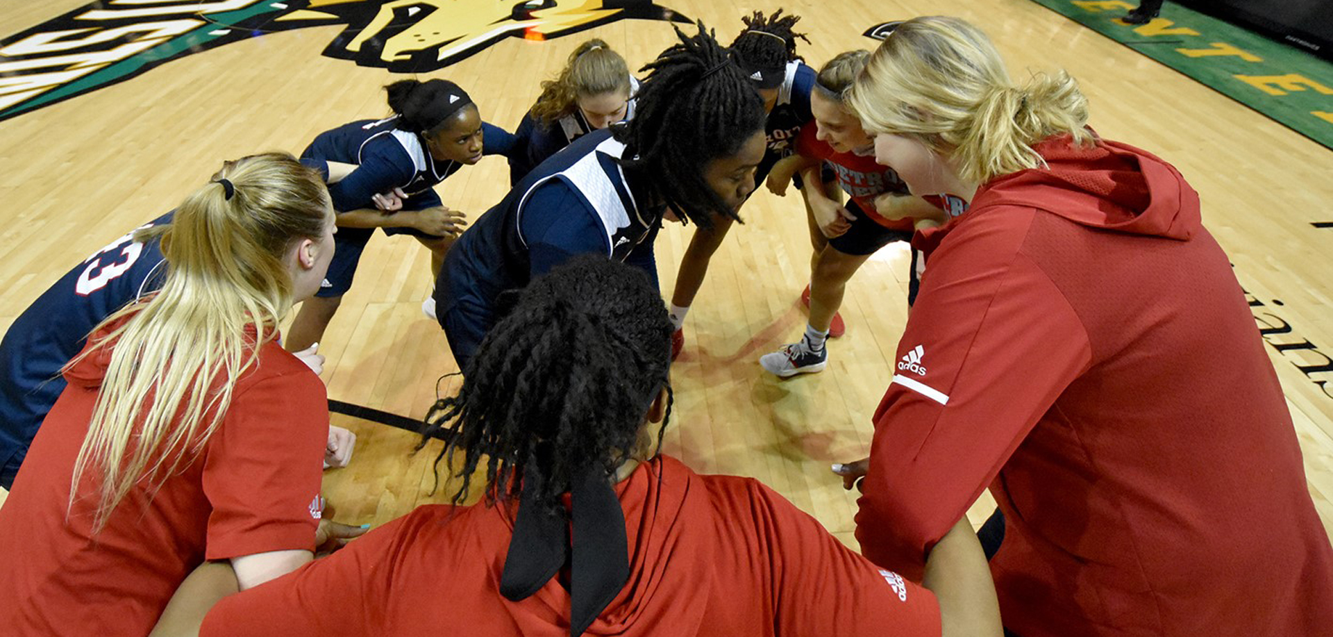 Women's basketball game huddle