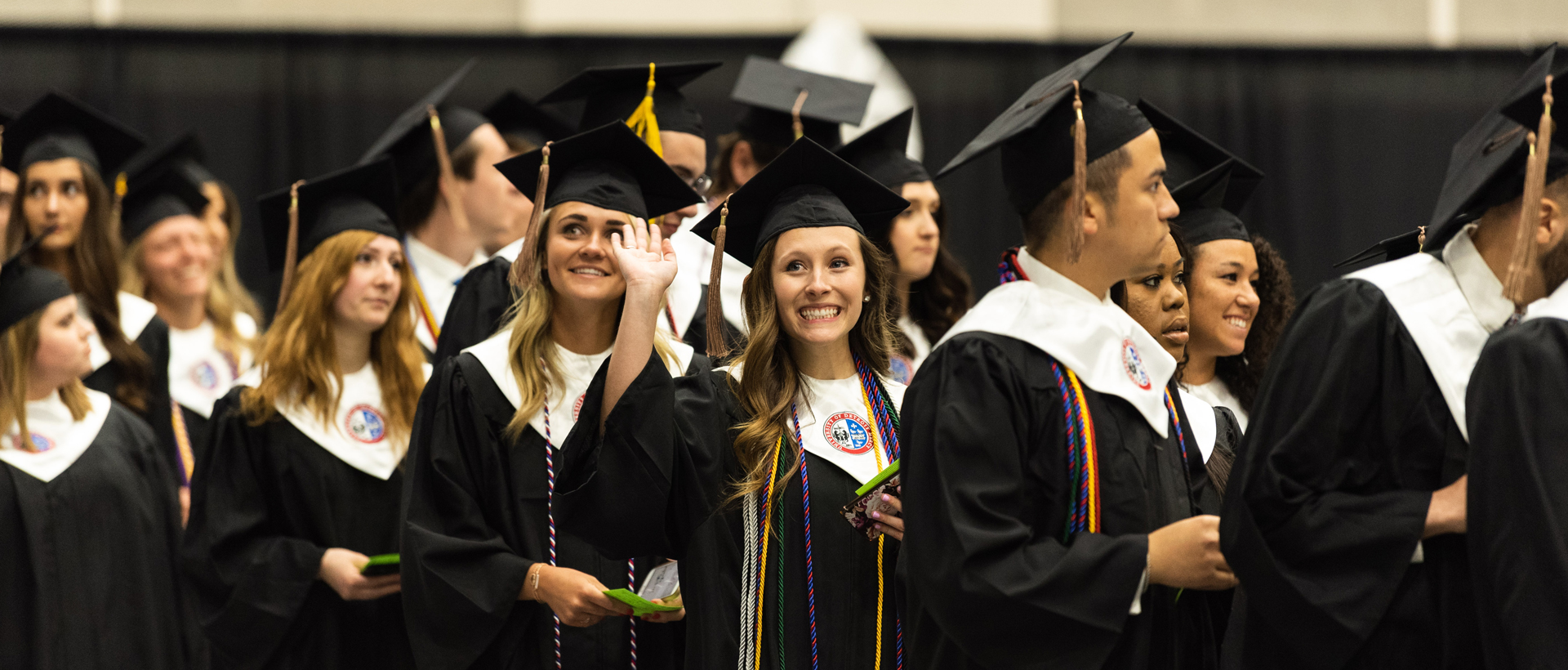 Group of female graduates smiling at Detroit Mercy Commencement